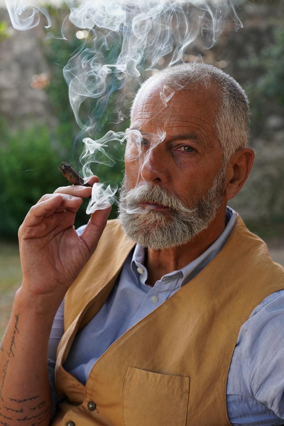 Smoking Toscano cigar, Mr. Roberto Giomi, Catador of Cigar Club Association, Lucca, Tuscany, Italy.